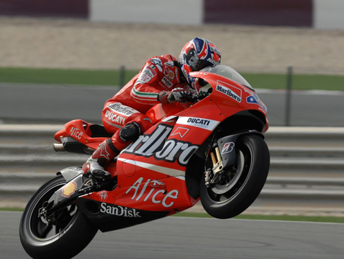 Casey Stoner pulls wheelie after maiden victory in Doha - Qatar MotoGP 2008